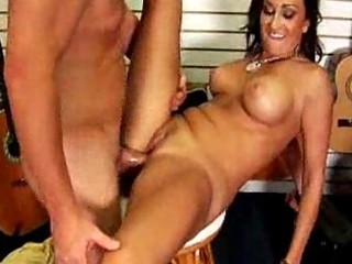big titty woman whore copulates the guitar store
