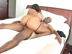 large ass dark momma in fishnet nylons takes her