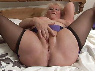 big granny squeezing on her bedstead