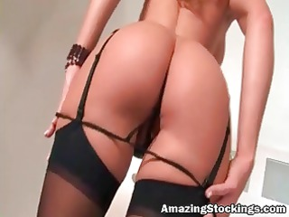 busty woman into sexy black stockings playing