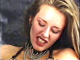 older blond dominatrix restrains brunette chick