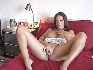 lady young gets white cream sprayed when dildoing
